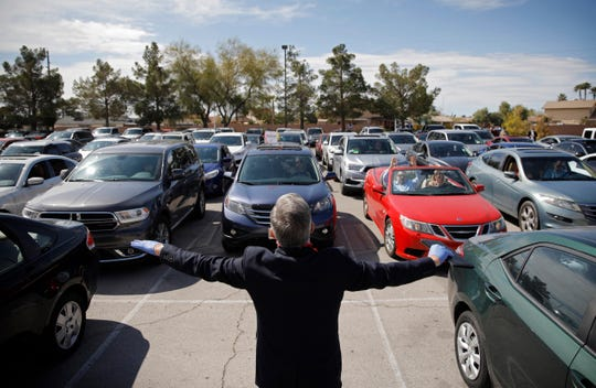 Pastor Paul Marc Goulet prays to people in their cars at an Easter drive-in service at the International Church of Las Vegas. There has been talk of holding drive-in concerts during the coronavirus pandemic.