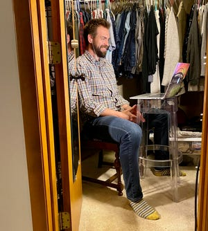 """Zac Parsons records his new podcast """"Conversations in the Middle"""" from a makeshift studio in his closet at home."""