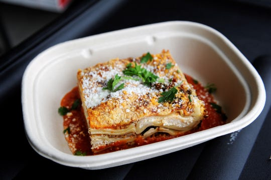 A lasagna Bolognese meal from P Fresh Kitchen, available at Azzip Pizza locations.
