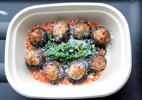 Italian sausage stuffed mushrooms with spinach from P Fresh Kitchen, available at Azzip Pizza locations.