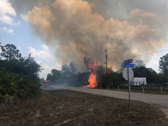 Brush fire in Lehigh Acres near 44th street and 46th Street Sunday, April 12, 2020. Conditions will be right on Thursday for any fires that start to spread quickly in parts of Lee and Charlotte counties.