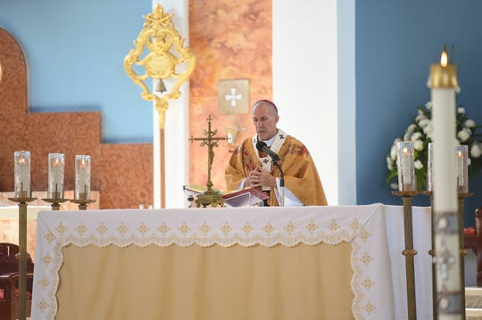 Archbishop Michael Jude Byrnes presides over Easter Sunday Mass in the midst of the coronavirus outbreak on Guam, at Dulce Nombre de Maria Cathedral-Basilica in Hagåtña, April 12, 2020.