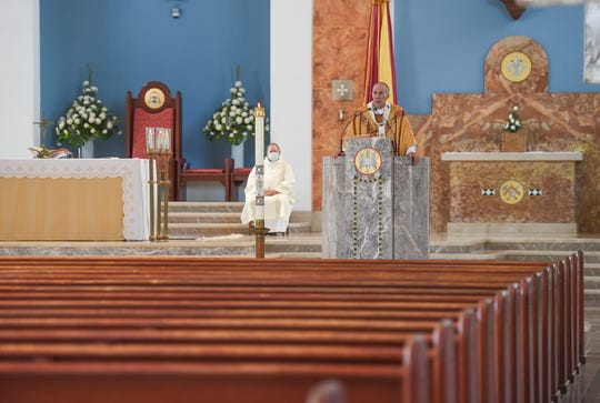 Archbishop Michael Jude Byrnes delivers his Easter Sunday Mass sermon to empty pews during the COVID-19 pandemic at Dulce Nombre de Maria Cathedral-Basilica in this April 12 file photo.