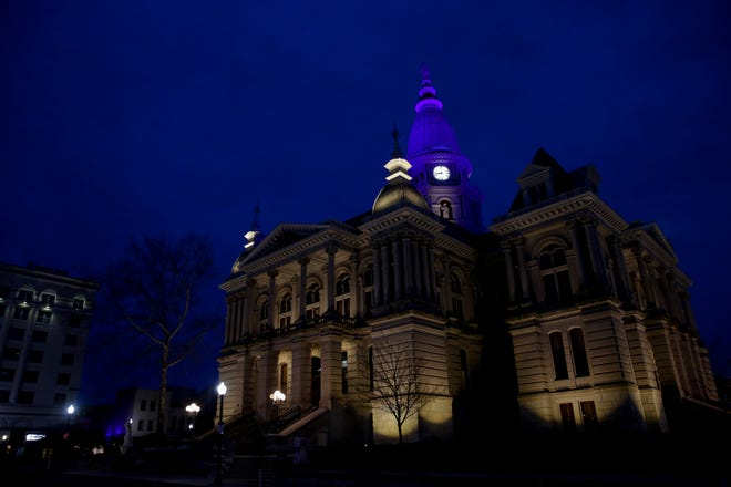 The Tippecanoe County Courthouse is lit in blue for those battling Covid-19 on the front line, Friday, April 10, 2020 in Lafayette.