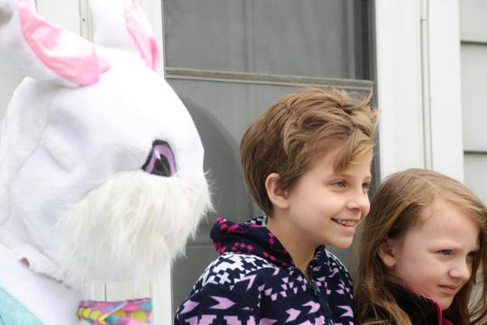 The Easter Bunny, poses with Graice Mendez and Rosie Church.