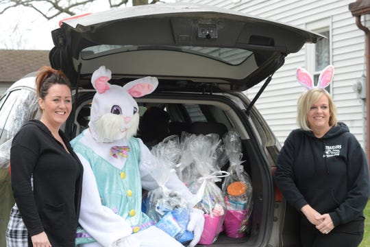 Jessica Simms, her husband Billy, and Diane Traxler gave baskets filled with candy to nearly 150 children during Easter weekend.
