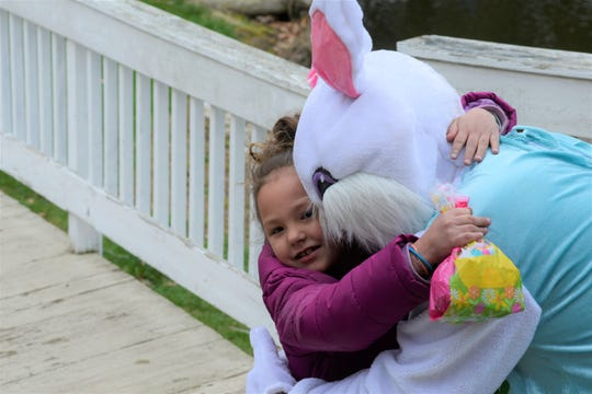 Khloe Kole briefly defied social distancing guidelines to hug the Easter Bunny on Sunday morning.
