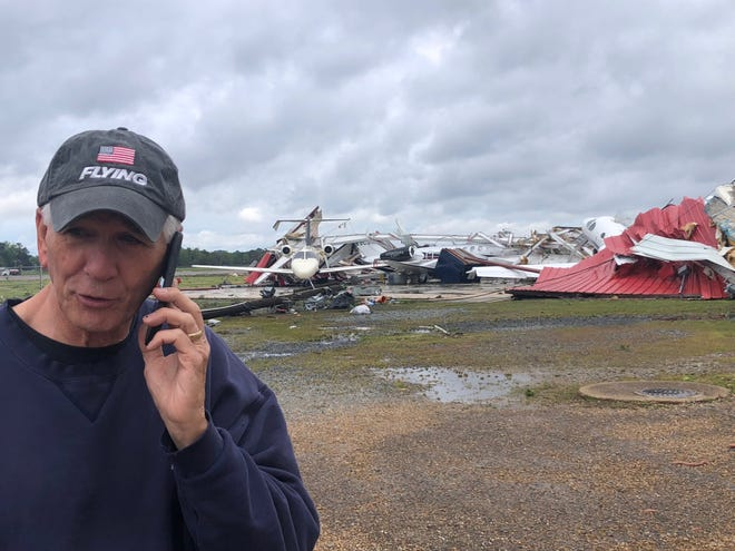 U.S. Rep. Ralph Abraham speaks to Louisiana Governor John Bel Edwards from Monroe Regional Airport on Sunday. A hangar at the airport was heavily damaged by an Easter tornado on April 12, 2020.