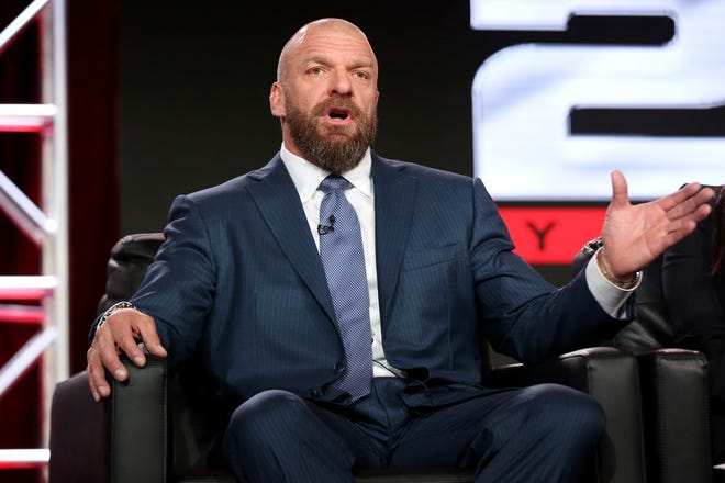 """In this Jan. 9, 2018, file photo, Paul """"Triple H"""" Levesque participates in the """"WWE Monday Night Raw: 25th Anniversary"""" panel during the NBCUniversal Television Critics Association Winter Press Tour in Pasadena, Calif. While real sports have shut down in the wake of the coronavirus pandemic, WWE has pressed on and ran its first WrestleMania in an empty arena last weekend."""