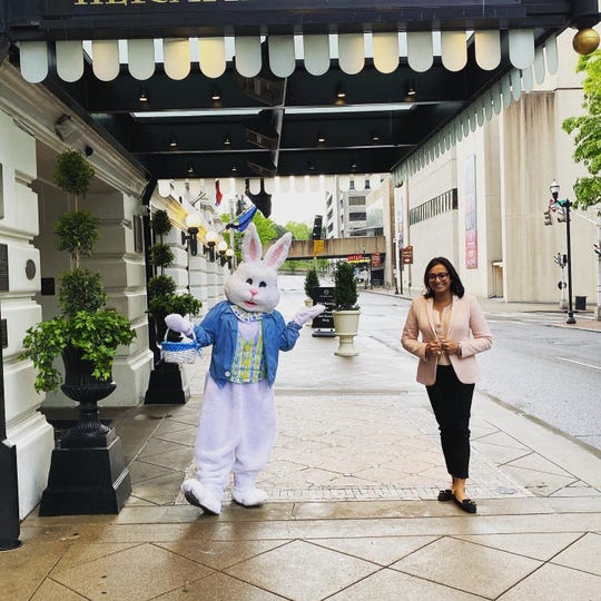The Easter bunny (Soledad Bardas) and Hermitage Hotel Managing Director Dee Patel outside the Sixth Avenue North hotel on Sunday, April 12, 2020.