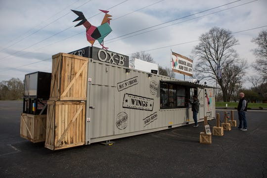 OX-B's has just opened in the parking lot of Ollie's on North 21st Street in Newark. The restaurant, which operates out of a shipping container, specializes in fast-cooked wings with a variety of dry runs and sauces. They also serve sides like Mac and cheese, baked beans and corn bread. Customers can order at the walk up or drive through window, or order ahead and pick up their food.