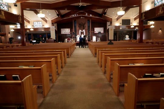 Sacred Heart Catholic Church sits mostly empty on Easter Day due to California's stay-at-home order during the coronavirus outbreak on Sunday, April 12, 2020 in Palm Desert, Calif.