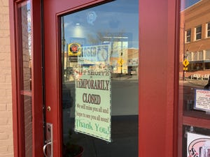 Signs indicate closures in Winslow.