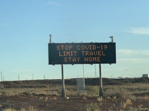 Signs while traveling to Navajo Nation Tribal community has been struck by the  coronavirus pandemic.