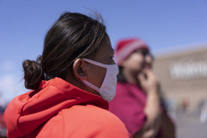 Navajo Nation tribal member Chris Long, 32, and his girlfriend Shannon Monroe, 30, from Birdsprings came to shop at Walmart in Winslow, Ariz. The tribal community has been struck by the new coronavirus pandemic.