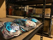 """Nice Package orders in bulk, so the """"condom cage"""" has nearly 120,000 individually wrapped condoms on its shelves."""