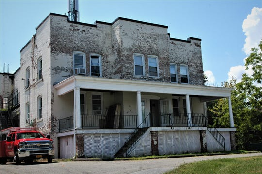 Located at 139 Rombout Avenue in the City of Beacon, today's apartment building was once the front entrance to a former school and hat factory.