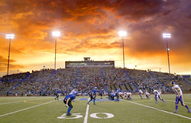 The Lake View Chiefs and Abilene Wylie Bulldogs are shown in a game at San Angelo Stadium.