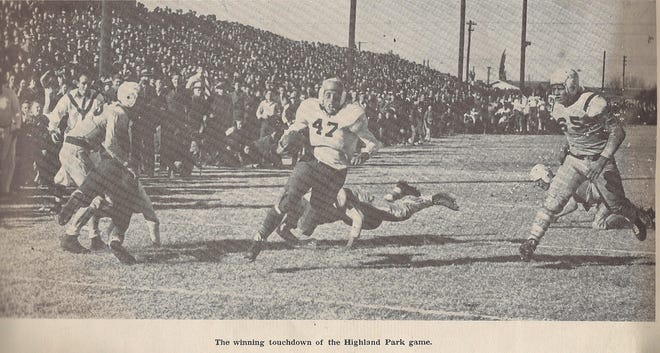 Mickey Rathbone runs in a late touchdown to tie Dallas Highland Park in their 1943 state semifinal game at Old Bobcat Stadium. George Graham's ensuing extra point gave the Bobcats a 21-20 win. They won the state title the following week 26-13 over Lufkin.