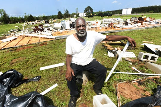 Roderick Sykes sits where his trailer was that was destroyed in the storm and now lays behind him in the Kingston-Frierson area of DeSoto Parish.