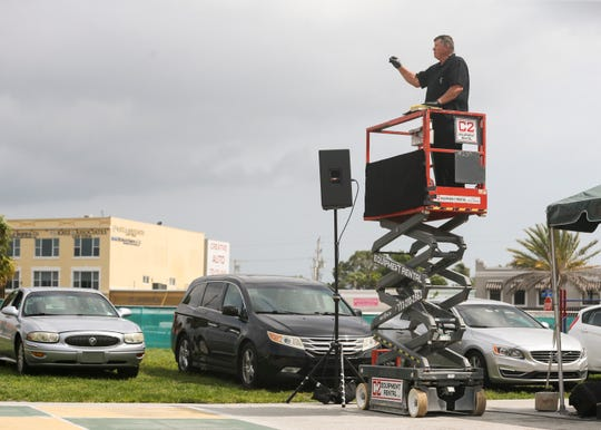 """The Rev. Dr. Darrell Orman gives a sermon during a drive-in Easter service in the First Baptist Church of Stuart's parking lot on Sunday, April 12, 2020, in Stuart, Fla. Because of the new coronavirus pandemic, the church congregation could not worship together inside the church. About 75 vehicles lined the parking lot for prayer, song and worship. """"The whole world every day, all day long, is being reminded of our mortality,"""" said Orman. """"You and I are to share the mercy, the forgiveness and the abundant life of the Lord Jesus Christ in a time like this."""""""