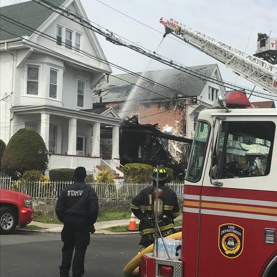 Fire officials battling a fire in Mount Vernon. April 12. 2020