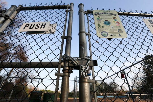 Talley Day Park's bark park is locked up after New Castle County authorities added fenced bark parks to the amenities closed as part of social distancing restrictions.
