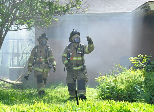 Wichita Falls firefighter work to control a house fire Sunday afternoon at a house located on Alamo Drive.