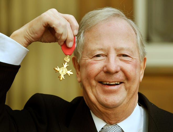 Tim Brooke-Taylor proudly holds his Order of the British Empire medal after it was presented by Prince Charles in 2011. The comedian has died after contracting coronavirus.