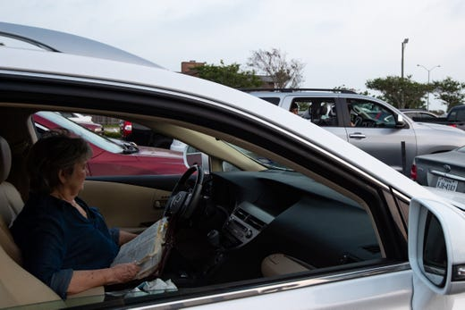 A parishioner of the First Baptist Church Corpus Christi holds a bible as she prays during a drive-in Easter service lead by Pastor Brian Hill on Sunday, April 12, 2020. First Baptist Church Corpus Christi had not held an in-person serves since Nueces County issued a stay at home order do to the COVID-19 outbreak.