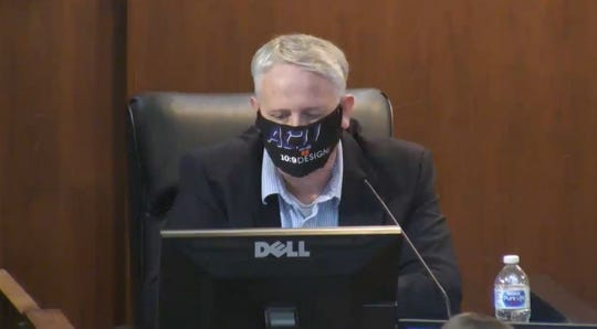 City Council Shane Price and other members wore protective masks during the special meeting on Monday.