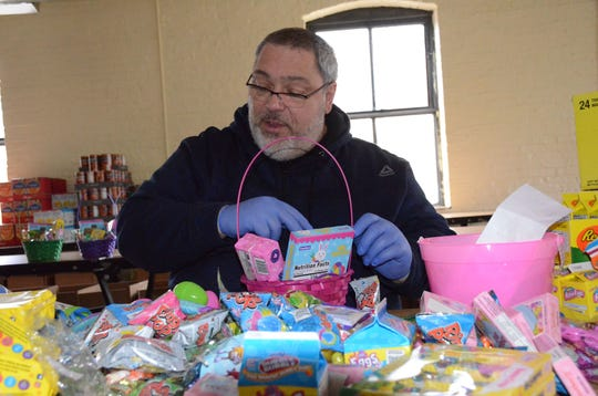 Alphonse Bifulco has collected food and candy for Easter boxes for four years. Trace Christenson/The Enqurier