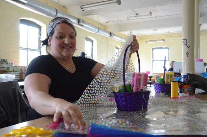 Theresa Weaver of Union City prepares an Easter basket of candy. Trace Christenson/The Enquirer