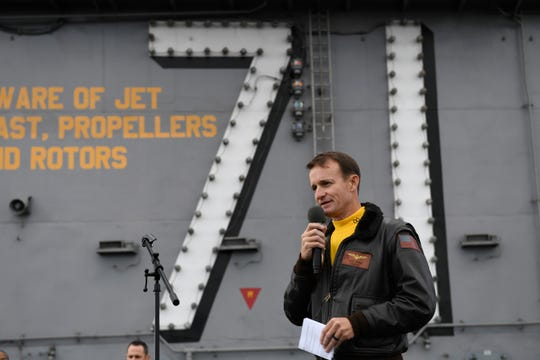 FILE — In this Nov. 15, 2019, photo U.S. Navy Capt. Brett Crozier, commanding officer of the aircraft carrier USS Theodore Roosevelt (CVN 71), addresses the crew during an all-hands call on the ship's flight deck while conducting routine operations in the Eastern Pacific Ocean.