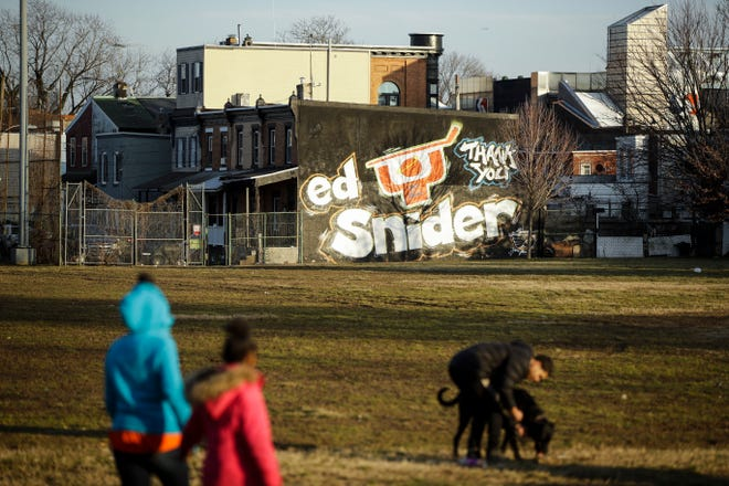 In this Feb. 21, 2019 photo a mural dedicated to Ed Snider is seen on the side of a home near the Scanlon Ice Rink in Philadelphia.