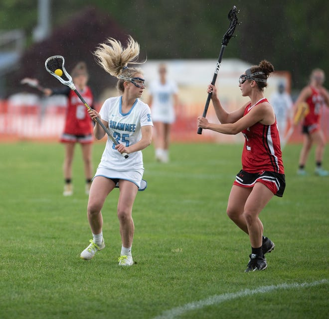 Shawnee senior Sami MacDonald, left, plays against Rancocas Valley last year.
