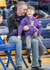Unioto coach Adam Dettwiller spends time with his son Ace before the start of the 2020 SVC wrestling tournament.