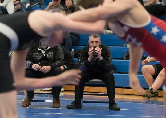 Unioto varsity wrestling coach Adam Dettwiller coaches from the side in a Division II sectional tournament at Washington Courthouse on Saturday, Feb. 23, 2019.