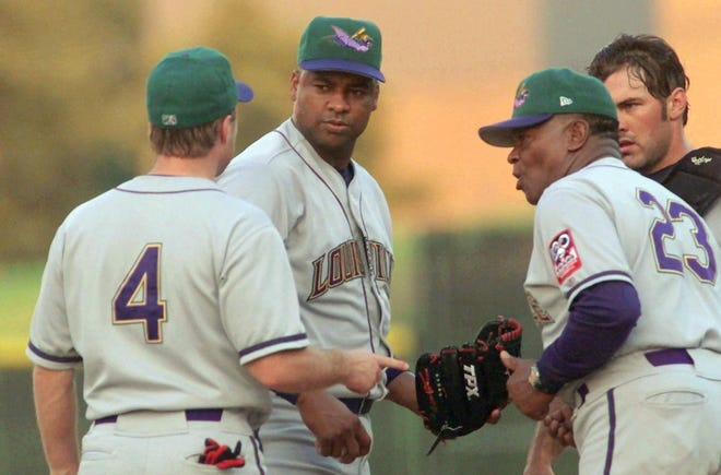 Louisville RiverBats pitcher Jose Rijo, second from left, talks with pitching coach Grant Jackson (23), shortstop Chris Sexton (4), and catcher Corky Miller during the third inning with the bases loaded against the Charlotte Knights on Saturday, July 14, 2001, in Fort Mill, S.C. Rijo, making his third start with the RiverBats, ptiched four innings, walked four, struck out two and gave up two earned runs on five hits.