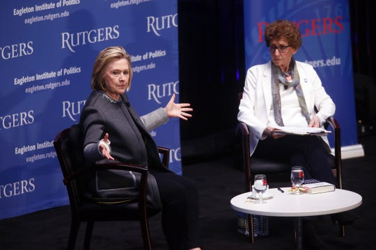 Hillary Clinton speaks with Ruth Mandel, the longtime director of Eagleton Institute of Politics at Rutgers University in 2018. Mandel died April 11 of ovarian cancer at the age of 81.