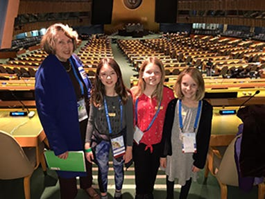 Jean Hicks, Director of Human Resources with students that attended the 2020 Model Montessori United Nations(MMUN)