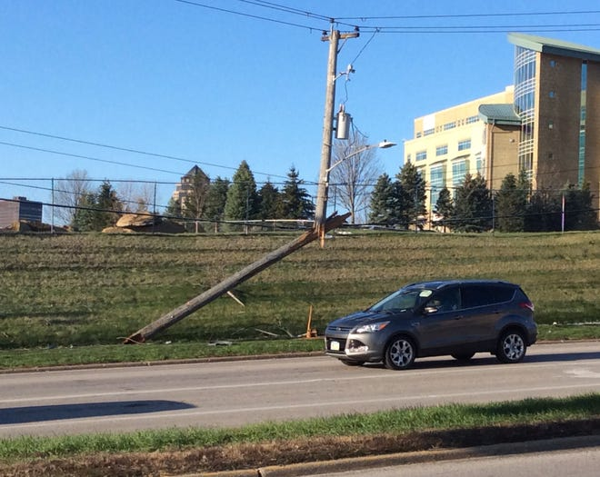 One power line was sheered off and a second was struck in a crash around 7:45 a.m. Monday, April 13, 2020, near MercyOne Medical Center in Des Moines. No injuries were reported.