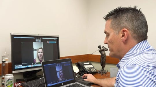 Dr. Tim McCoy demonstrates a telehealth appointment at the MercyOne South Des Moines Family Medicine Clinic.