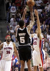 Spurs' Robert Horry shoots the go-ahead 3-pointer with under 10 seconds remaining in OT in Game 5 of the NBA Finals at the Palace, June 19, 2005.