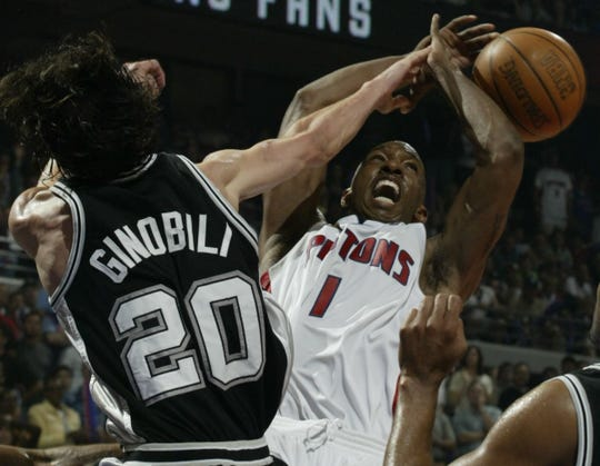 Pistons' Chauncey Billups battles for a shot with Spurs' Manu Ginobili during Game 5 of the NBA Finals, Sunday June 19, 2005 at the Palace of Auburn Hills.