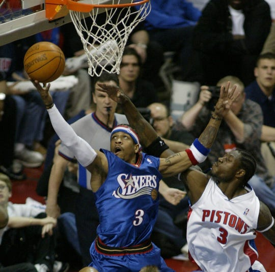 76ers' Allen Iverson drives under the Pistons' Ben Wallace during Game 5 of  the Eastern Conference semifinals at the Palace of Auburn Hills, May 14, 2003.