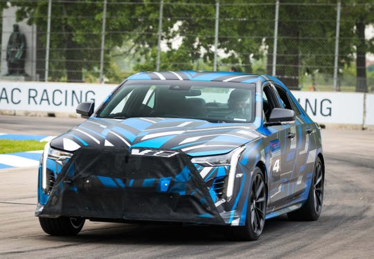 GM VP for Global Product Ken Morris drives the blue CT4 performance variant around Belle Isle in 2019. In production trim, the car will be called the CT4-V Blackwing.