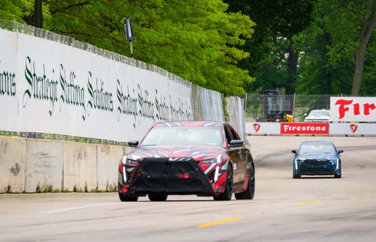 Cadillac offered a sneak peek at the future of Cadillac's V-Series as two prototypes took a lap around the Chevrolet Detroit Grand Prix presented by Lear track in 2019. GM President Mark Reuss drives the lead, red CT5 and GM VP for Global Product Ken Morris drives the blue CT4. In production trim, the cars will be called the CT5-V Blackwing and CT4-V Blackwing, respectively.