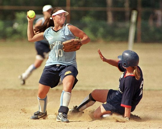 Bridget (Baxter) Orchard throws to first base for the Central Region during the 1999 Empire State Games at Stony Brook University.