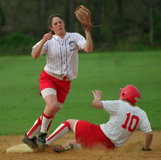 Shelly Burrell catches the ball at shortstop for Owego against Chenango Valley in 1997.
